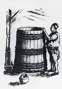Стопанинът нагласява каца под навес за слагане сливи за варене на ракия. Вместимост: 600–800–900 литра.